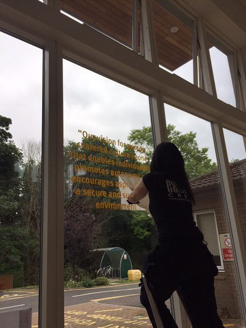 adding lettering to a window