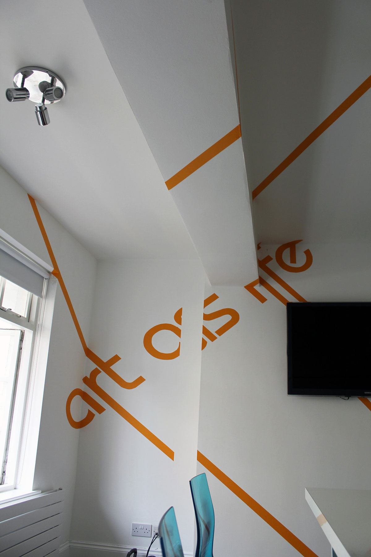 anamorphic graphics with writing on the wall