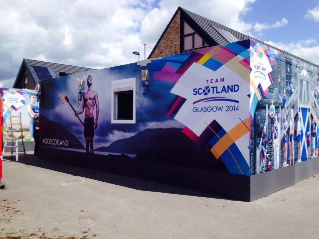 athletes village hut with scotland team written on it for the commonwealth games 2014