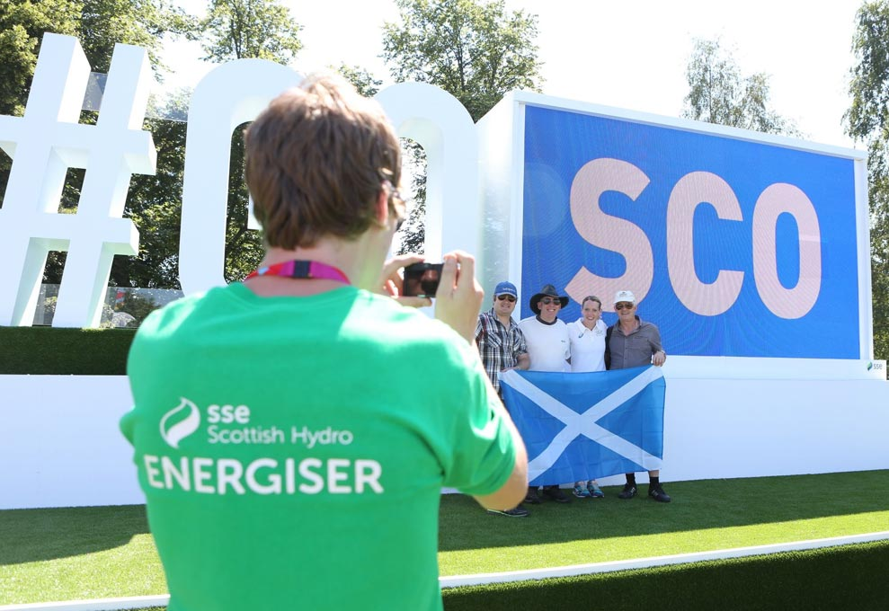 #gosco sign with some people taking a picture with athlete Eilidh Doyle