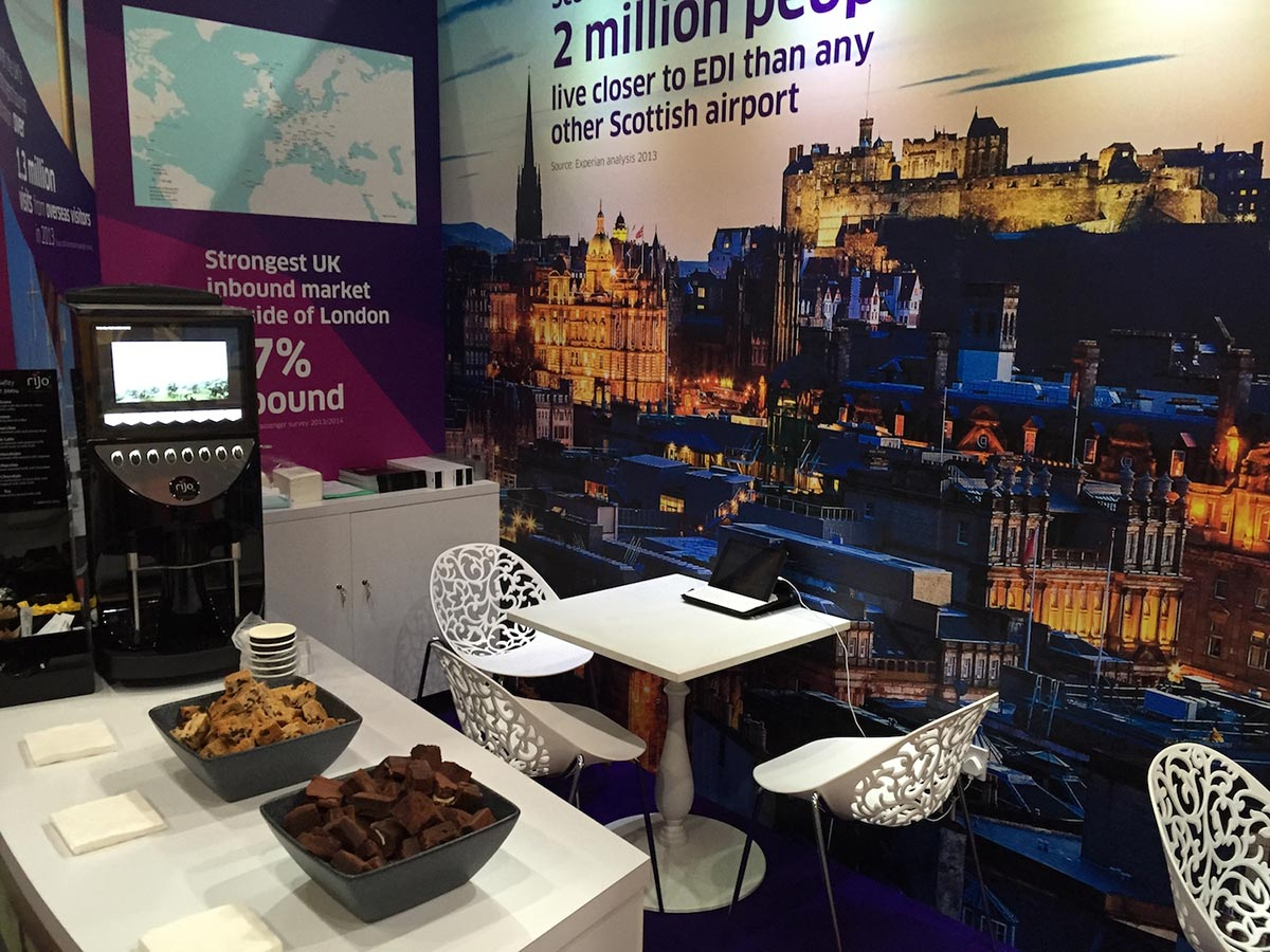 edinburgh airport exhibition stand with snacks, coffee machine and table and chairs