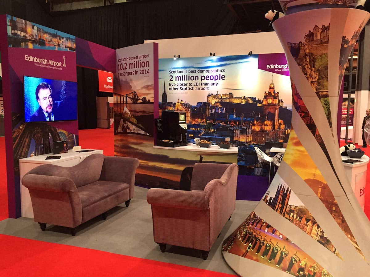 edinburgh airport exhibition stand with seating area and TV screen