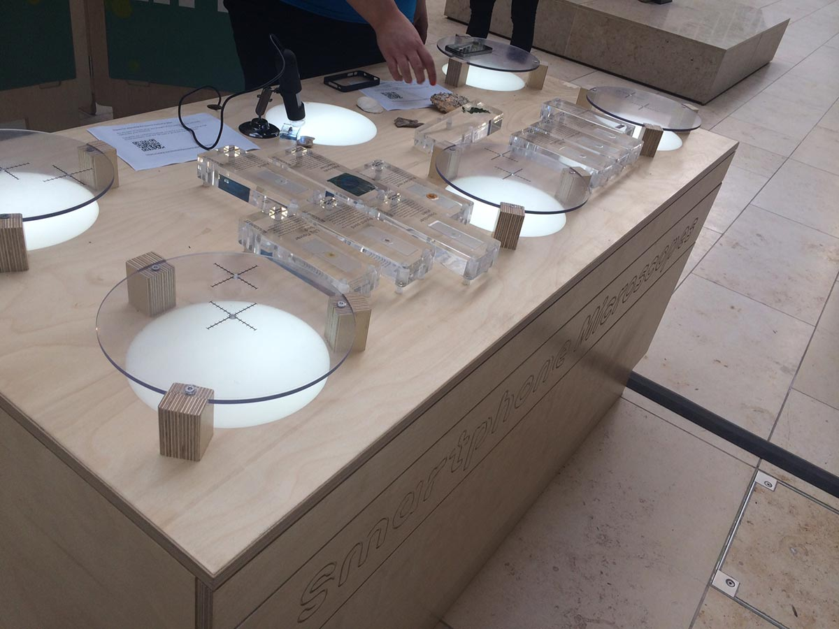 science exhibition - display for smartphones and microscopes