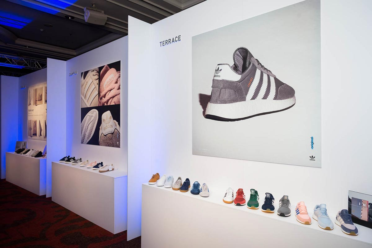 adidas trainers in a row at an event