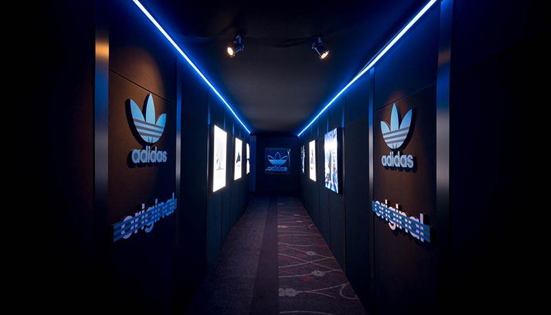 hallway with adidas branding on each side