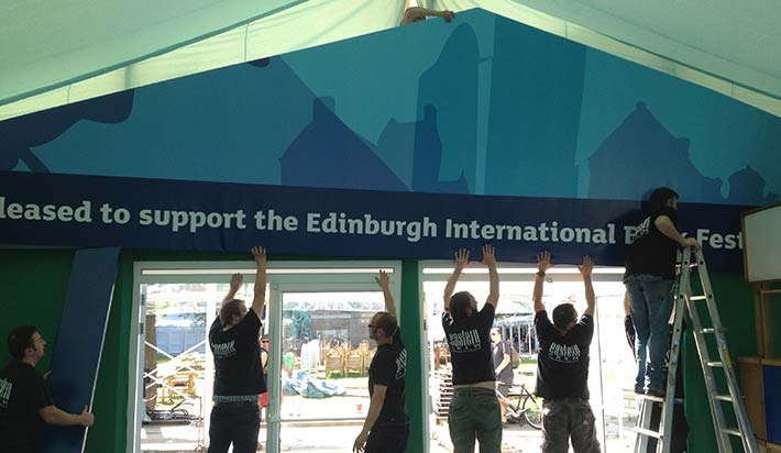 putting up the edinburgh book festival sign
