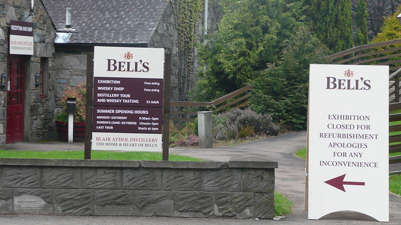 visitor signs outside for bells whisky distillery