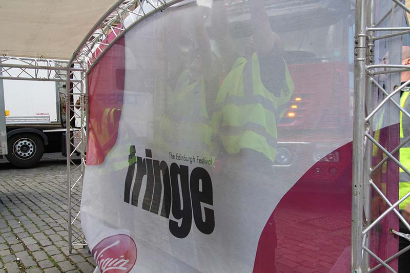 edinburgh fringe signs being installed