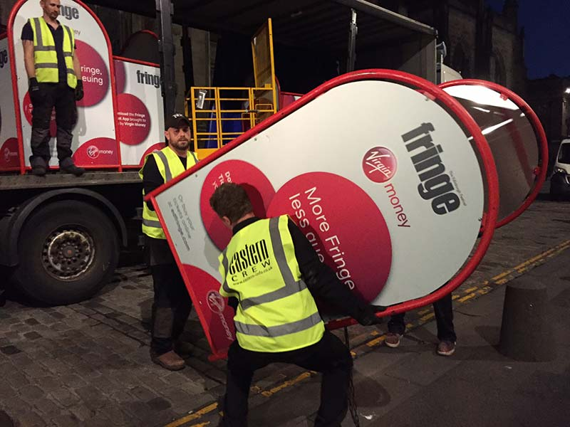 eastern workers unloading edinburgh fringe installations