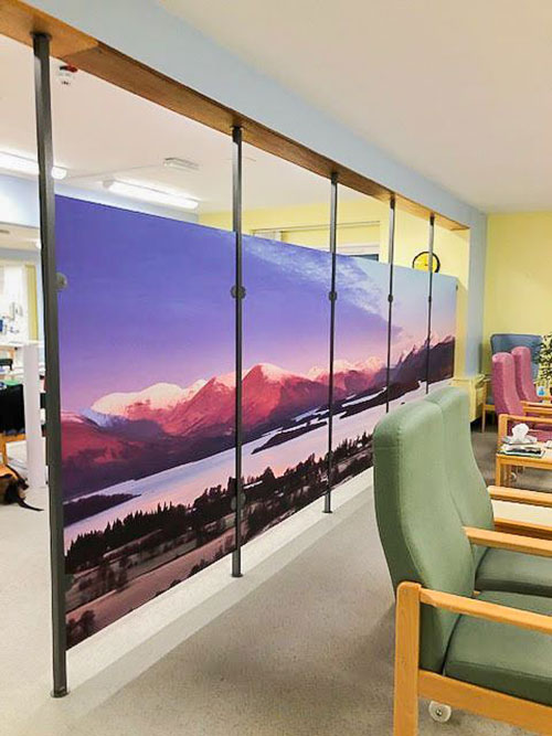 hospital waiting room with mountain scene on glass