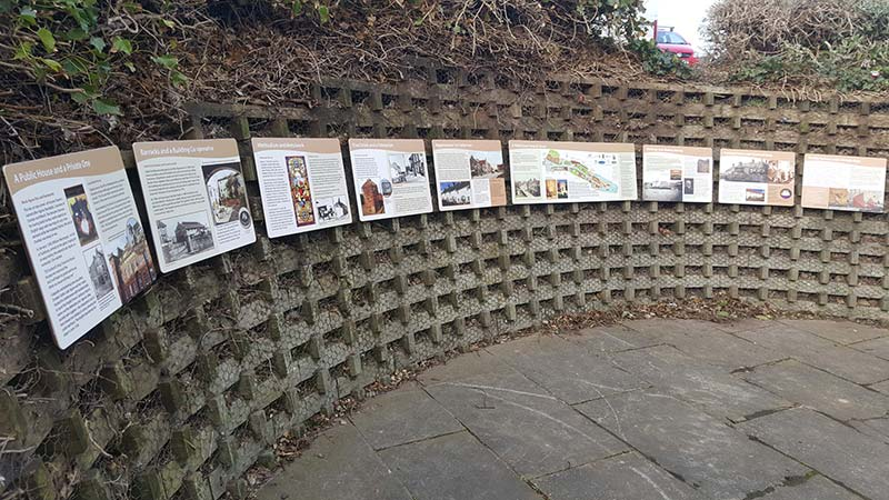 information signs for tourists on a wall