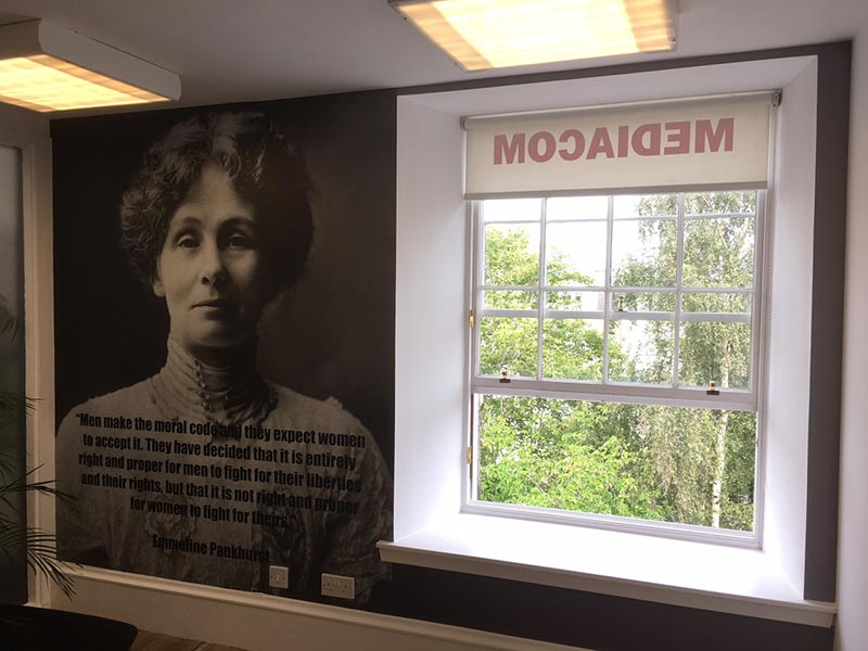 Office Interior with some text and picture on the wall and an open window