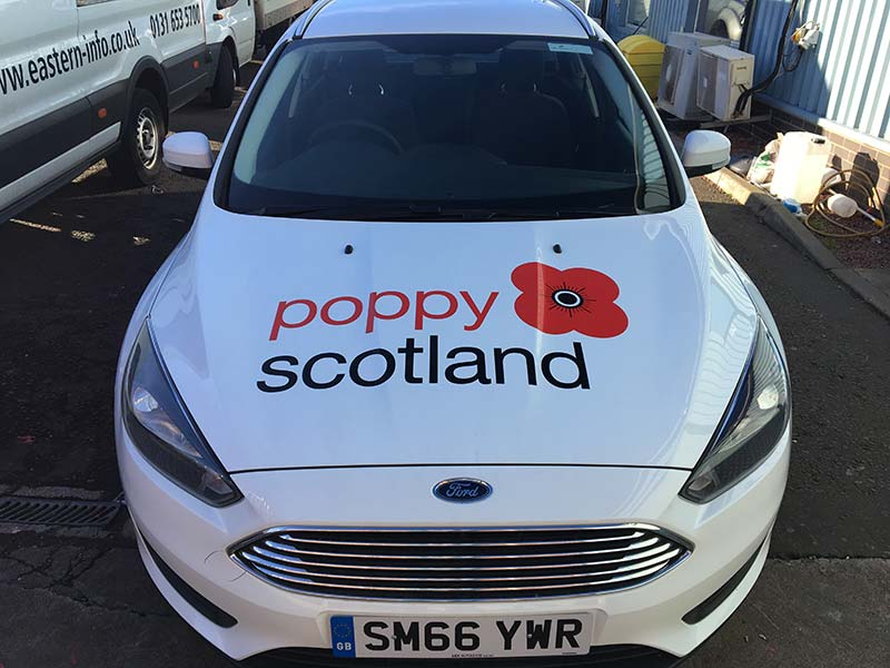 new poppy scotland signage on their car