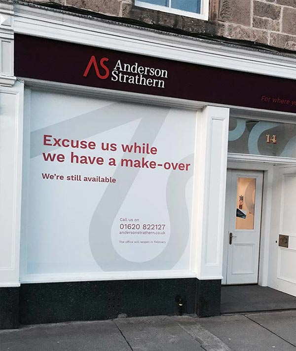 having a make over message shopfront hoarding