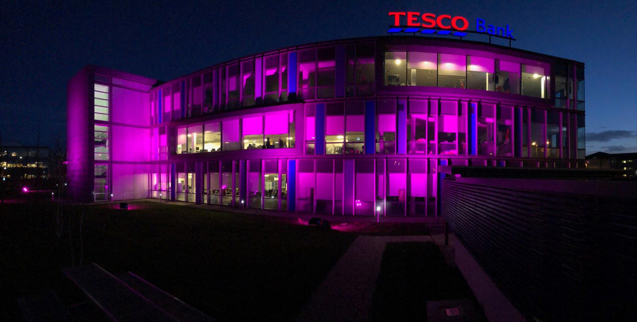 tesco bank headquarters all lit up in aid of cancer research
