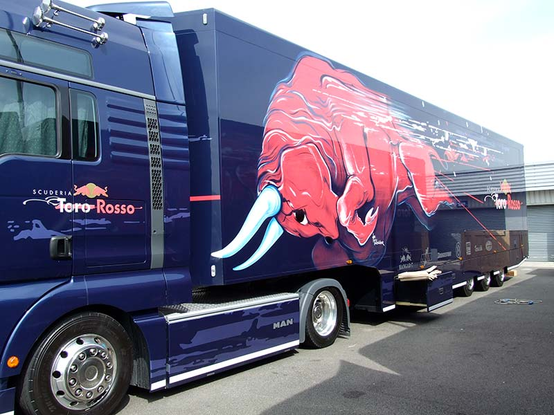 toro rosso truck from the side showing of the new red bull