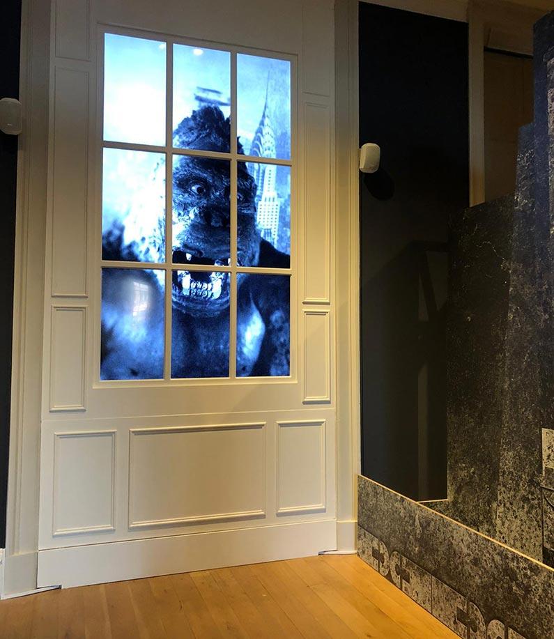 king kong in the window of a door