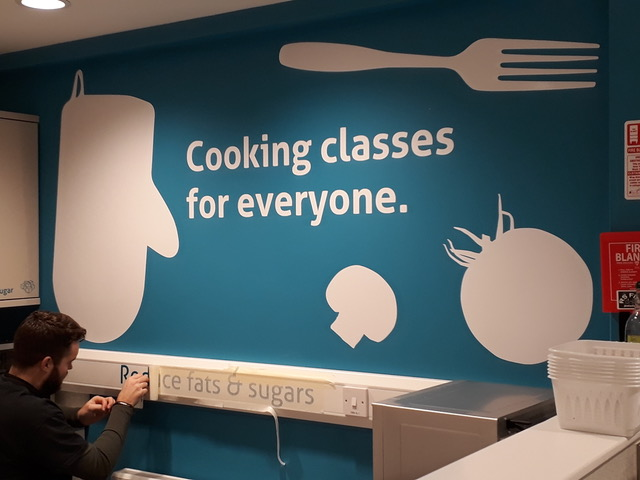 painted wall with message - cooking classes for everyone.