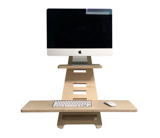 3d rendering of the standing desk with mac screen and keyboard
