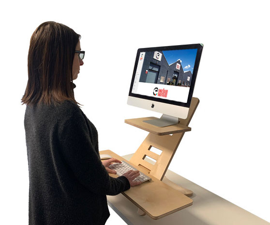 person at the standing desk looking at their computer screen