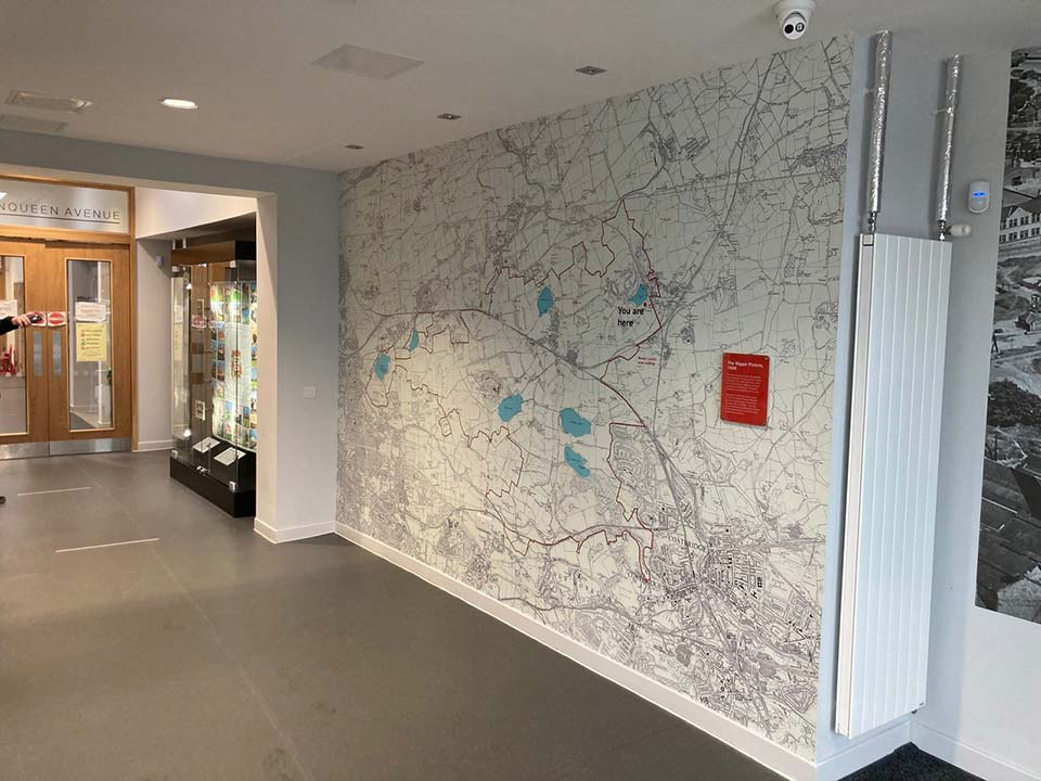 display case and wallpaper map graphic