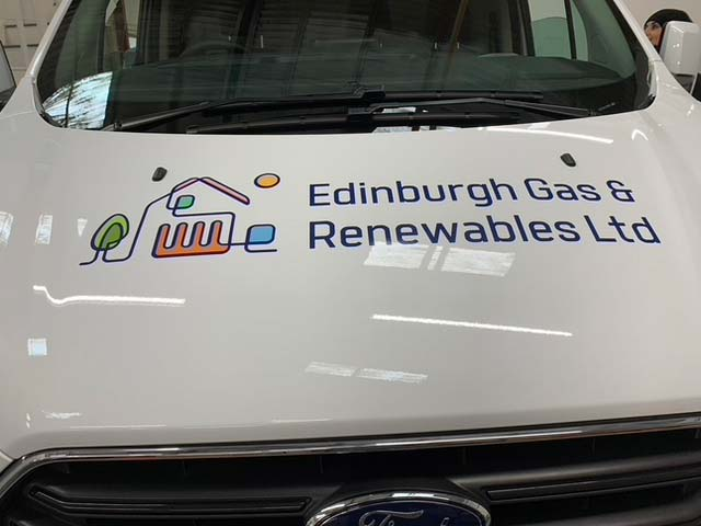 front of the van with graphic writing applied