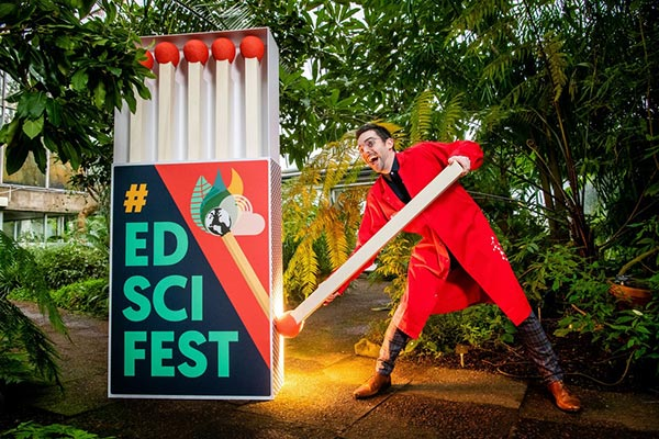 edinburgh science festival giant matchbox with man trying to light a match